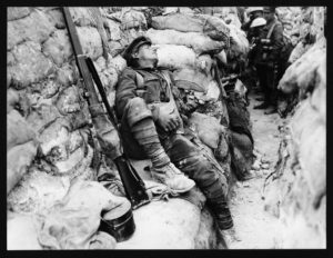 Soldier asleep in the trenches in World War One