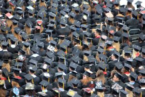 Aerial view of students wearing mortar boards at a graduation ceremony