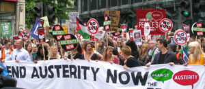 Demonstrators and People's assembly banner at an Anti-austerity protest