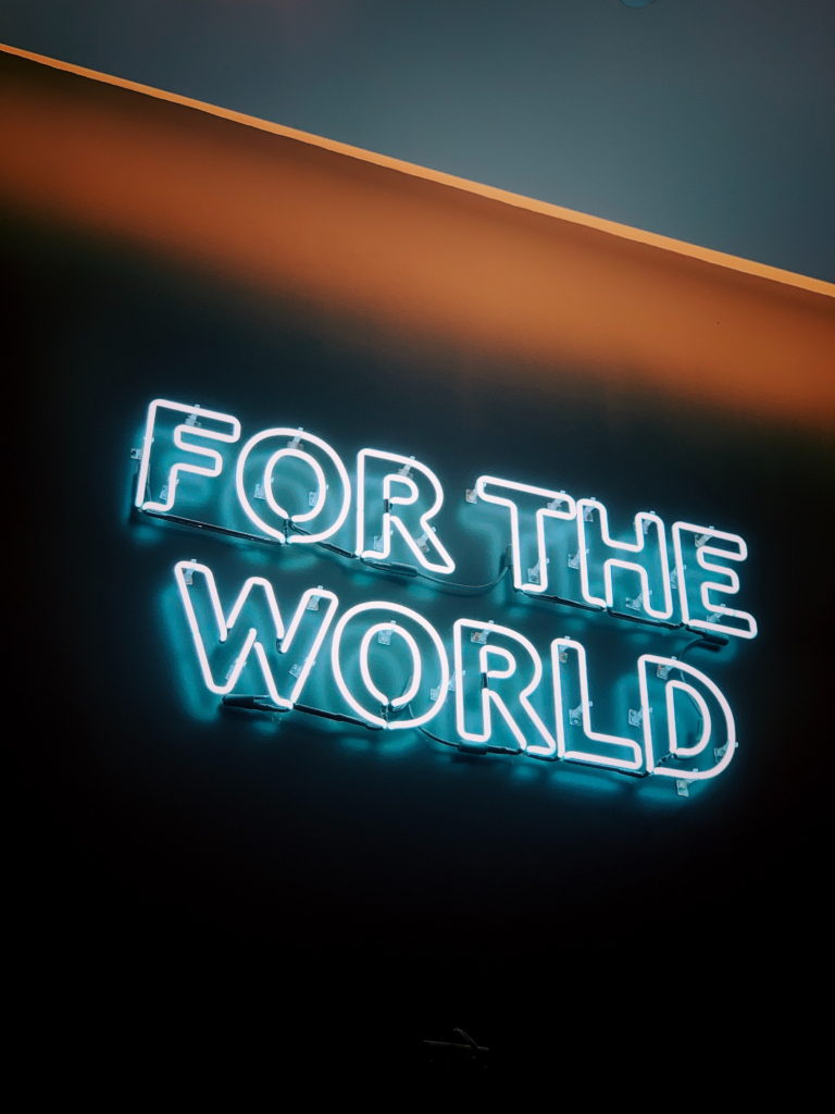 Neon sign slogan For the World