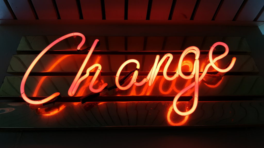 "Neon sign with the word ""change"""