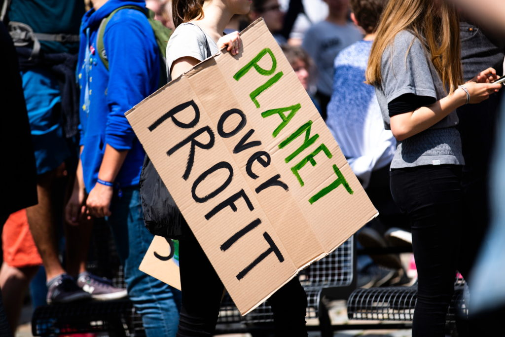 "Placard at a demonstration with the slogan ""Planet over Profit"""