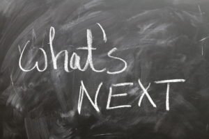 "Chalk board with the words ""what's next"" written on it"