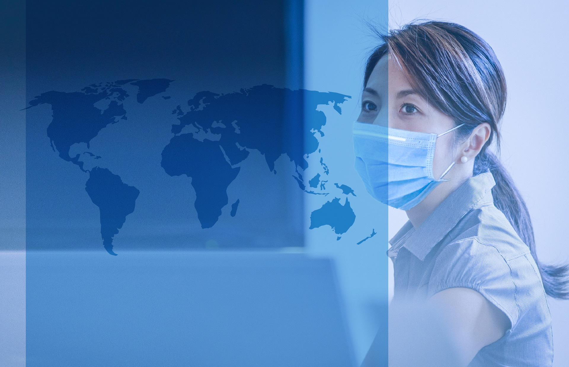 Woman doctor wearing face mask with looking at a map of the world